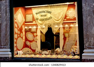 BRUSSELS, BELGIUM - AUGUST 16, 2018: Window of souvenir shop with famous belgian lace samples on it.