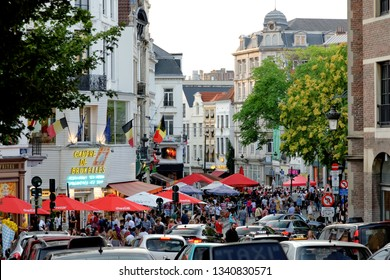 BRUSSELS, BELGIUM - AUGUST 16, 2018: Crowded with tourists rue de la Madeleine street enjoying shopping in the center of Brussels. Brussels is one of the famous shopping centers in Belgium.