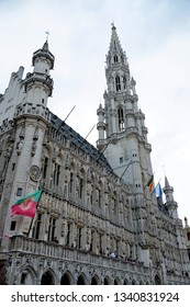 BRUSSELS, BELGIUM - AUGUST 16, 2018: The Town Hall, a gothic building from the Middle Ages, located on the famous Grand Place opposite the Museum of the City of Brussels.