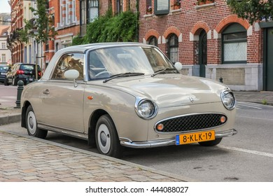 BRUSSELS, BELGIUM - August 17, 2013: Old school cars still used by population. On the streets of Brussels, summer, tourism, in August 2013.