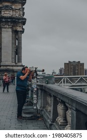 Brussels, Belgium - August 17, 2019: Man using binoculars on the viewing platform in Brussels, the capital of Belgium and a popular city break destination.