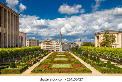 Brussels, Belgium - August 20, 2014: A sunny day at Mont des Arts, with people walking and sitting on benches.