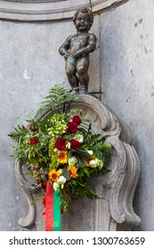 Brussels, Belgium - August 5th 2012: A view of the historic Manneken Pis sculpture in the city of Brussels in Belgium.