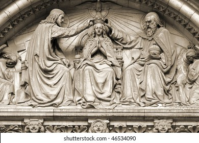 Brussels, Belgium. Church exterior: Notre Dame de la Chapelle. Coronation of Virgin Mary sculpture. Religious theme.