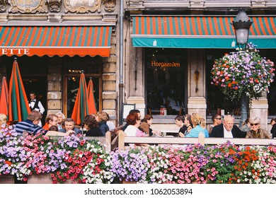 BRUSSELS, BELGIUM - CIRCA AUGUST 2009: Flowers-filled outdoor cafes around the Grand Place (Grand Square or Grand Market) in central Brussels, Belgium