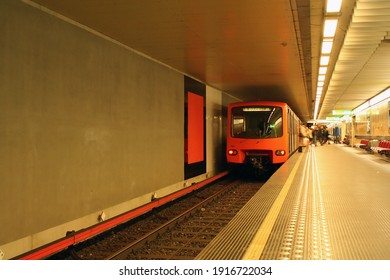 Brussels, Belgium - december 02, 2005: The orange subway (underground aka metro) train standing on the station and blurred people moving in and out of train