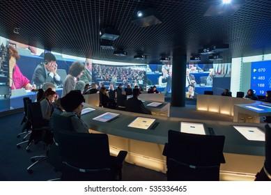 BRUSSELS, BELGIUM - DECEMBER 05 2016 - Tourists visiting the European Parliament visitors center Parlamentarium at the Espace Leopold (Leopold Square)