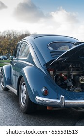BRUSSELS, BELGIUM - DECEMBER 1, 2013: Retro car Volkswagen Beetle Oval Type 1 with opened hood parked at the Cinquantenaire park during vintage car expo.
