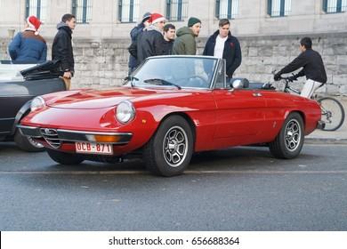 """BRUSSELS, BELGIUM - DECEMBER 1, 2013: Red Alfa Romeo Spider Junior 1.6 (1974) """"Coda Tronca"""" (Series 2) at the Cinquantenaire park during annual winter Oldtimer meeting"""
