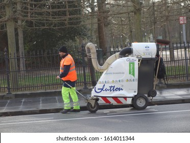 Brussels, Belgium - December 24, 2019: Workers using Glutton Zen electric street sweeper. Glutton is a Belgian leader in street cleaning