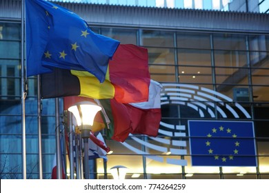 Brussels, Belgium - December 8, 2017: Sign and EU flag symbol on glass walls of Berlaymont, that houses the headquarters of the European Commission, which is the executive of the European Union