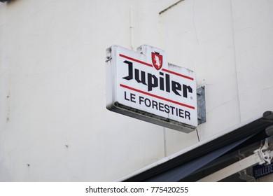 Brussels , Belgium - December 8, 2017: Jupiler beer signage. Belgian beer introduced in 1966, now brewed by Anheuser–Busch InBev, it is the biggest-selling beer in Belgium