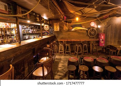 BRUSSELS, BELGIUM: Empty bar with old schooner interior, old barrels, wooden furniture and pub counter without bartenders on April 2, 2018. More than 1,200,000 people lives in Brussels