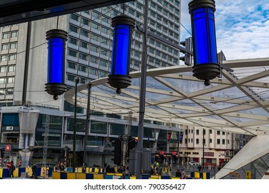 BRUSSELS, BELGIUM - FEBRUARY 2, 2017:  Decorative lights hanging from the entrance of City2 shopping mall with the huge Place Rogier canopy in the background.