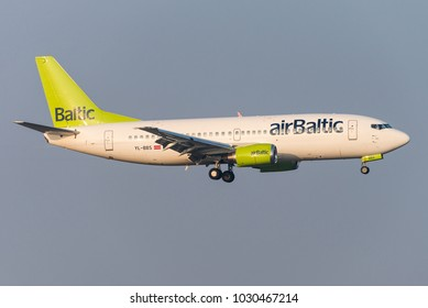 BRUSSELS, BELGIUM - FEBRUARY 21, 2018: An airBaltic Boeing 737-300 (YL-BBS) is landing at Brussels airport on February 21, 2018. AirBaltic is a state-owned Latvian low-cost carrier.