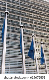 Brussels, Belgium - February 6, 2017: European Union flags in front of Berlaymont. The Berlaymont is an office building in Brussels, Belgium, that houses the headquarters of the European Commission
