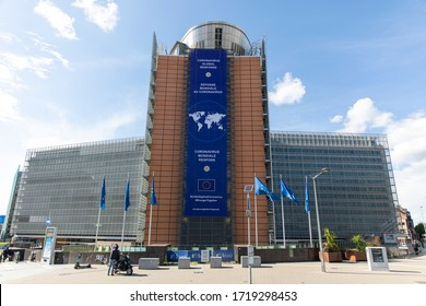 """BRUSSELS, Belgium - fourth of may 2020 : The """"Coronavirus - Global Response"""" banner displayed on the front of the Berlaymont building, the headquarters of the European Commission."""