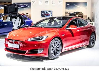 Brussels, Belgium, Jan 09, 2020: metallic red Tesla Model S P100D at Brussels Motor Show, produced by American automaker Tesla, main shareholder Elon Musk,