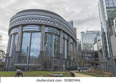 BRUSSELS, BELGIUM - Jan 12,2017: European Parliament towers and European flags. Brussels, Belgium.