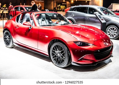 Brussels, Belgium, Jan 18, 2019: metallic red Mazda MX-5 at Brussels Motor Show, Fourth generation, ND2, lightweight two-passenger roadster manufactured and marketed by Mazda