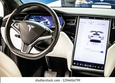 Brussels, Belgium, Jan 18, 2019: metallic white Tesla Model X at Brussels Motor Show, produced by American automaker Tesla, main shareholder Elon Musk, control board, steering wheel, upholstery, seats