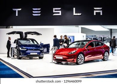 Brussels, Belgium, Jan 18, 2019: metallic red Tesla Model 3 and blue Tesla model X at Brussels Motor Show, produced by American automaker Tesla, main shareholder Elon Musk,