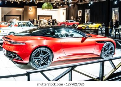 Brussels, Belgium, Jan 18, 2019: metallic red Aston Martin DBS at Brussels Motor Show, Dream Cars, British super grand tourer manufactured by Aston Martin