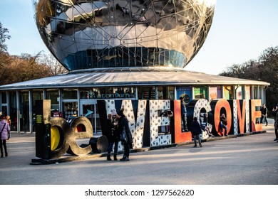 Brussels, Belgium, Jan 19, 2019: be.Welcome word near The Atomium in winter, Atomium depicts nine iron atoms in shape of body-centred cubic unit cell of iron crystal,