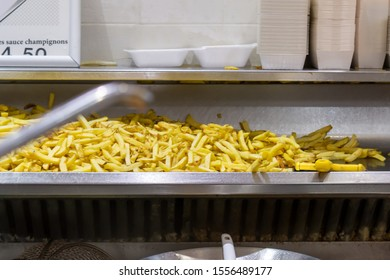BRUSSELS, BELGIUM - JANUARY 1, 2019: Street food - french fries in Brussels, Belgium on January 1, 2019.