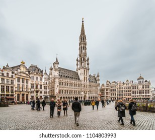 Brussels / Belgium - January 13 2018: People walk in the famous UNESCO heritage square in Brussels, Belgium