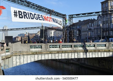 BRUSSELS, BELGIUM - January 20, 2017: Greenpeace organize demonstration for Bridges Not Walls: anti-Trump protesters have dropped banners on the bridge between Molenbeek and Brussels center