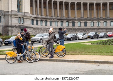 BRUSSELS, BELGIUM - JANUARY 3, 2019: Tourists on bikes in Park of the Fiftieth Anniversary in Brussels on January 3, 2019.