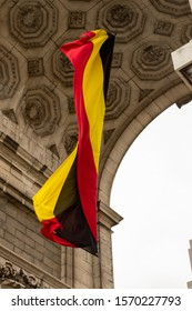 BRUSSELS, BELGIUM - JANUARY 3, 2019: Belgium flag at triumphal arch in Park of the Fiftieth Anniversary in Brussels on January 3, 2019.