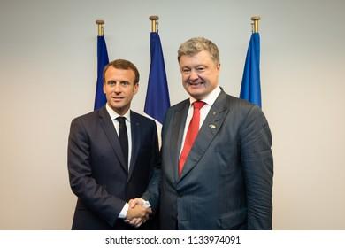 BRUSSELS, BELGIUM - Jul 12, 2018: Ukrainian President Petro Poroshenko and French President Emmanuel Macron during NATO military alliance summit in Brussels