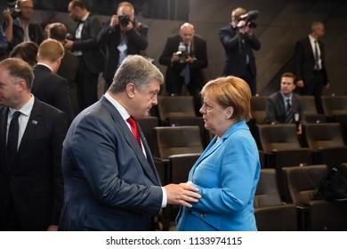 BRUSSELS, BELGIUM - Jul 12, 2018: Ukrainian President Petro Poroshenko and German Chancellor Angela Merkel during NATO military alliance summit in Brussels