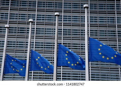 Brussels, Belgium - Jul. 25, 2018. European flags fly at half-mast at EU Commission headquarters in solidarity with the victims of the forest fires in Greece.