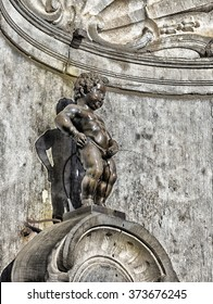 BRUSSELS, BELGIUM - JULY 10, 2015: Manneken Pis statue, one of the most famous Belgian and Brussels monuments and a symbol of the city