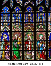 BRUSSELS, BELGIUM - JULY 12, 2015: stained glass window in the Church of Our Lady of Sablon (Notre Dame du Sablon) made in 1861 by the artist Samuel Coucke (1833-1899)