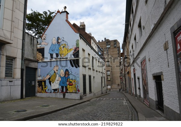 BRUSSELS, BELGIUM - JULY 14: Filtered picture of a comic strip mural painting on July 14, 2014 in Brussels, Belgium. Brussels is known as a homeland of comic strips and is full of comic murals.