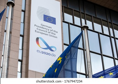 BRUSSELS, Belgium - july 1st, 2020: European flags blowing in front of the seat of the Council of the European Union, with the new banner of german rotating presidency