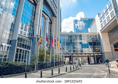 Brussels, Belgium - July 20, 2020: European Parliament offices and European flags.