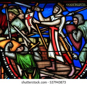 BRUSSELS, BELGIUM - JULY 26, 2012: Stained glass window depicting the First Crusade and Godfrey of Bouillon, in the cathedral of Brussels.