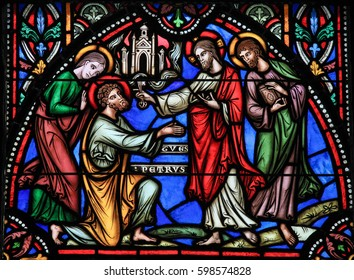 BRUSSELS, BELGIUM - JULY 26, 2012: Stained glass window depicting Jesus handing over the Keys to Heaven to Saint Peter, in the Cathedral of Brussels, Belgium.