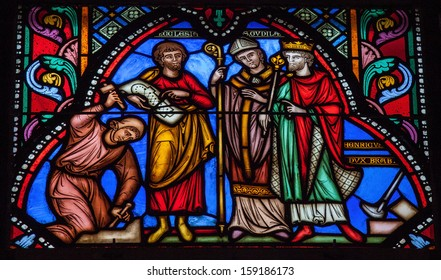 BRUSSELS, BELGIUM - JULY 26: Stained glass depicting Henry, Duke of Brabant, ordering the construction of the cathedral of Saint Michael and Saint Gudula in Brussels, Belgium, on July 26, 2012.
