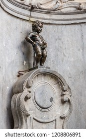 BRUSSELS, BELGIUM - JULY 6, 2014: Manneken Pis statue in Brussels. Statue of a pissing boy in a beautiful summer day in Brussels, Belgium on July 6 2014