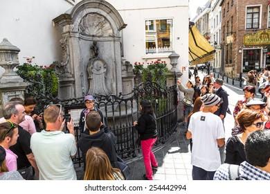 BRUSSELS, BELGIUM - JULY 6: Manneken Pis statue in Brussels. Statue of a pissing boy in a beautiful summer day in Brussels, Belgium on July 6 2014