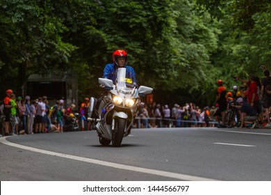 BRUSSELS, BELGIUM - JULY 7, 2019: Belgian police motorcade ahead of cyclists during time trial stage of the Grand Depart of Tour de France race in Brussels, Belgium