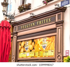 Brussels, BELGIUM - July 7, 2019:  classic Belgian frites with choice of sauces, plus burgers and snacks in Brussels, Belgium on July 21, 2019