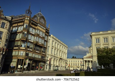 Brussels, Belgium - July 8, 2017: View of the facade of the Musical Instruments Museum (MIM) from the Coudenberg (Rue Montagne de la Cour) with pedestrians and road traffic in under the clear blue sky