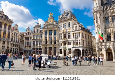 BRUSSELS, BELGIUM - JUNE 04, 2017: People walking in square of the Grand Place in summer day in Brussels